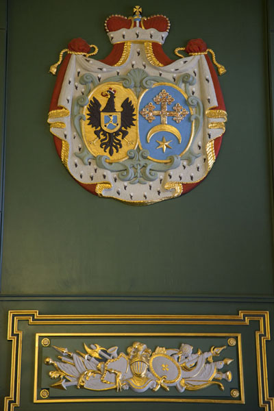 Decorations with coat of arms of the Radzivili family on the wall of a room in the palace of Njasvizh | Njasvizh | Belarus