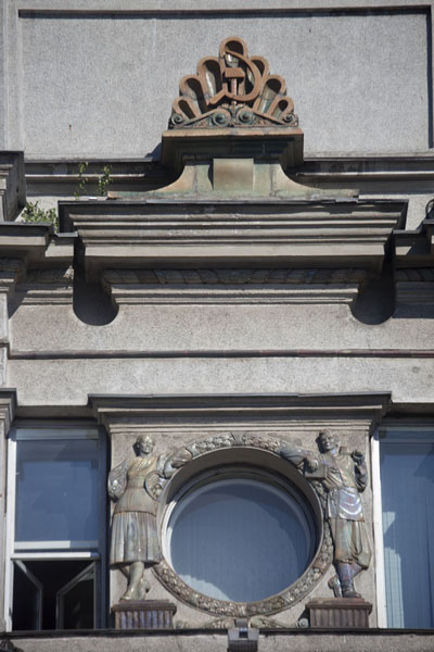 Picture of Hammer-and-sickel and sculpted figures adorning a building on Nyezhavisimosty AvenueMinsk - Belarus