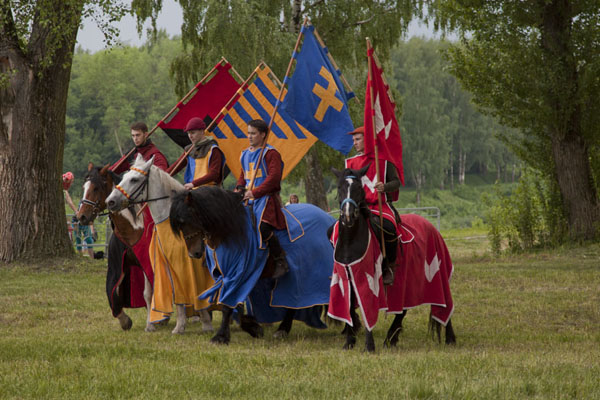 Dressed up in medieval clothes, horsemen with flags on a festival | Polatsk | Belarus