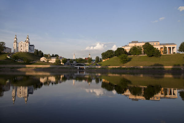 Sunset over the river Dvina at the confluence with the Vitba river with the church of the Assumption and Art Museum | Vitebsk | Belarus