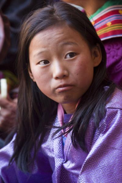 Girl in purple: attending a tsechu in elegant clothes - 不丹