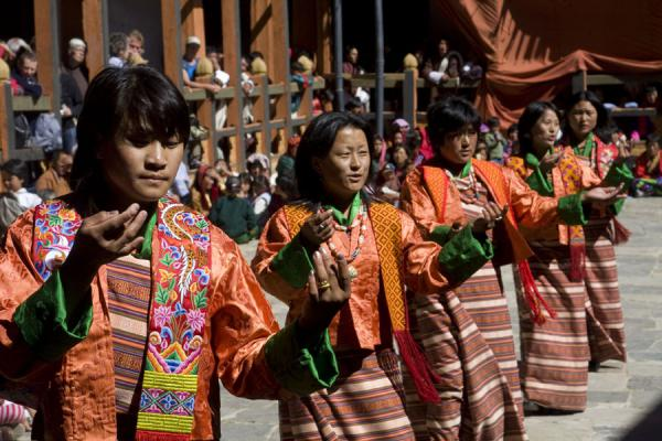 Women performing a traditional dance as an interlude during a tsechu | Bumthang Tsechu | Bhutan