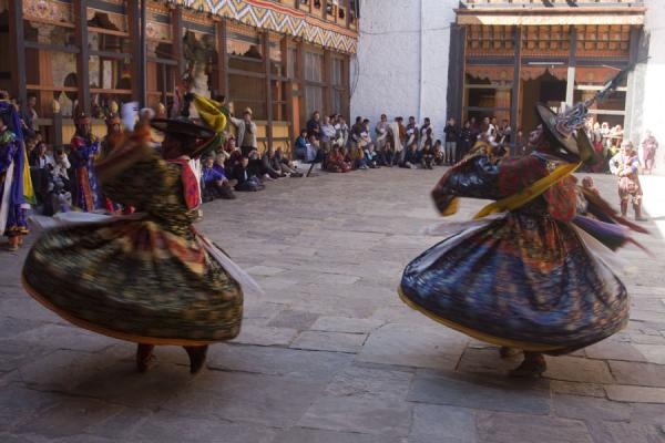 Monks swirling around with their amazing brocade dresses | Bumthang Tsechu | Bhutan