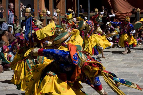 Monks with masks dancing the Kyecham | Bumthang Tsechu | Bhutan