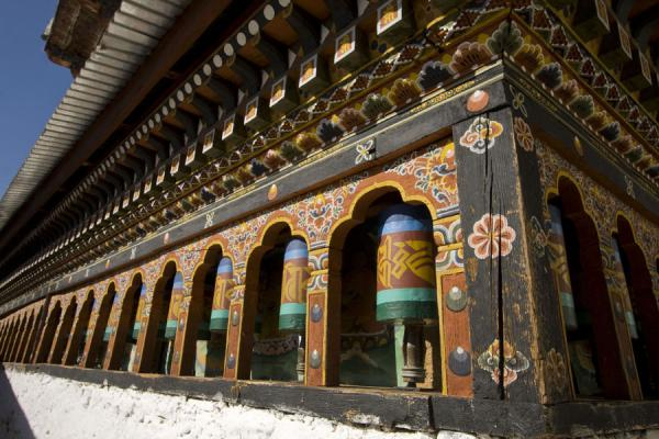 Picture of Cheri Monastery (Bhutan): Colourful prayer wheels at Cheri Monastery