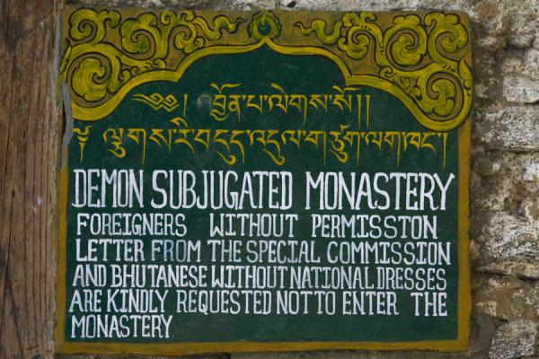Sign warning visitors of the demon subjugated monastery | Cheri Monastery | Bhutan