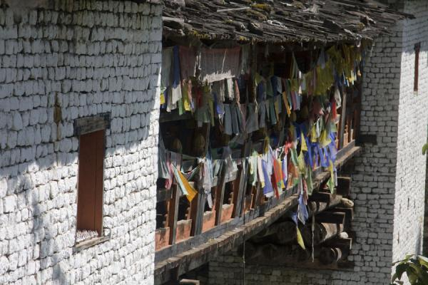 Picture of Cheri Monastery (Bhutan): Prayer flags adorning the bridge at the foot of Cheri Monastery