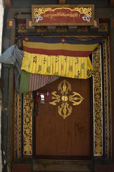 Wooden door with decoration | Cheri Monastery | Bhutan