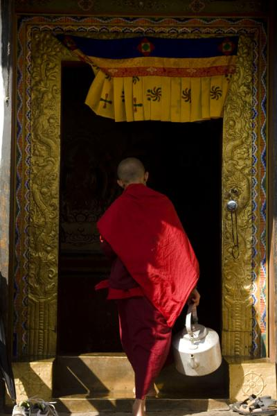 Picture of Chimi Lhakhang (Bhutan): Monk in doorway in Chimi Lhakhang