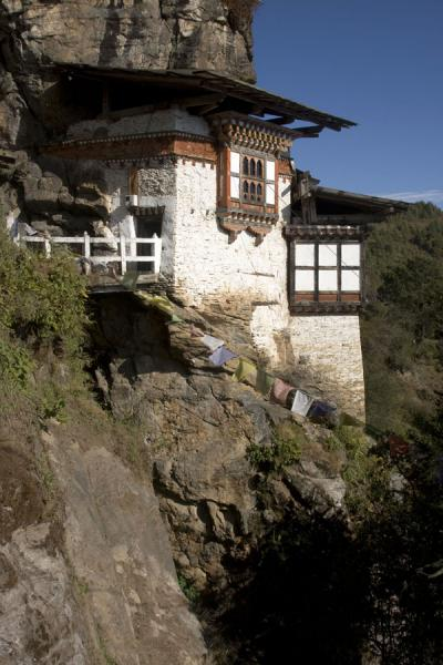 Foto van Kunzangdrak monastery is built against the rock faceKunzangdrak - Bhutan