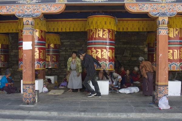 On the phone while turning the prayer wheel - 不丹 - 亚洲