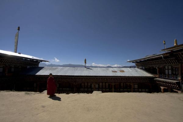 Monk with rooftops of Petsheling monastery | Petsheling monastery | Bhutan