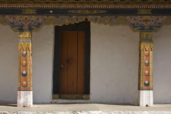 Picture of Corridor inside Punakha Dzong with wooden door and columns - Bhutan - Asia