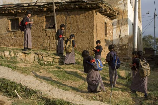 Schoolgirls getting ready for school in Rinchengang village |  | 不丹