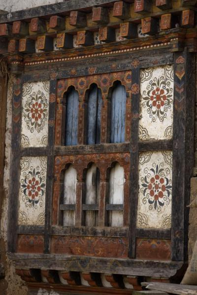 Wooden window painted with familiar Bhutanese patterns in Rinchengang | Rinchengang | Bhutan