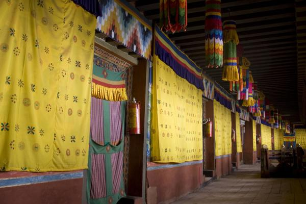 Picture of Colourful hallway with wall paintings covered by yellow cloth