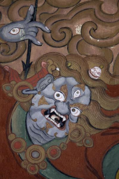 Three-eyed deity with eyes in his hand depicted on outside wall of Thimphu Dzong | Thimphu Dzong | Bután