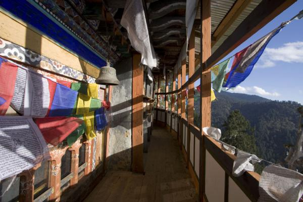 Prayer flags flying off the balcony of Thowada Goemba | Thowada Goemba | Bhutan