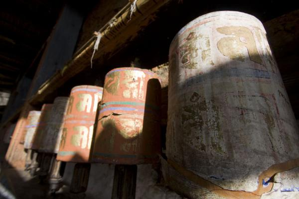 Some of the old, worn prayer wheels at Thowada Goemba | Thowada Goemba | Bhutan