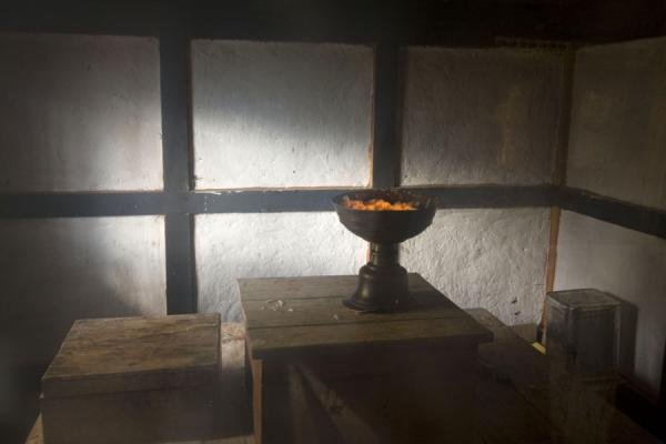 Burning butter lamp was the only sign of life at Thowada Goemba | Thowada Goemba | Bhutan