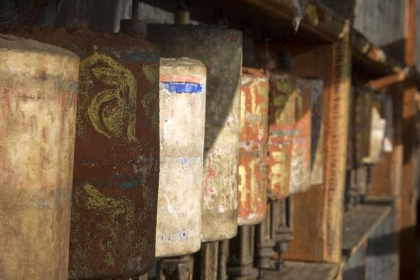 Picture of Old prayer wheels in the afternoon sun at Thowada Goemba
