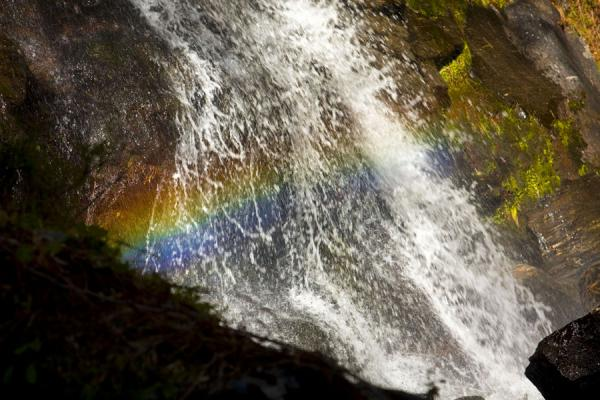 Foto van Rainbow seen in the waterfall near TaktsangTaktsang - Bhutan