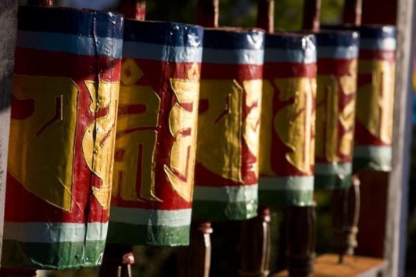 Picture of Tiger Nest Monastery (Bhutan): Colourful prayer wheels on the trail to Taktsang, Tiger Nest Monastery