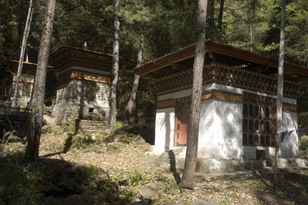 Water prayer wheels at the foot of the mountain cliffs at Taktsang | Tiger Nest Monastery | Bhutan