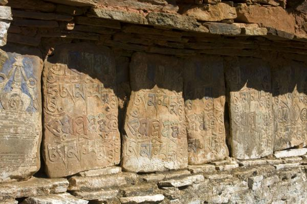 Prayer stones and prayer wall at the entrance to Ugyen Chholing Palace | Ugyen Chholing Palace | Bhutan