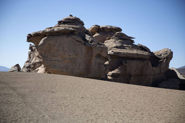 Rock formation rising from the landscape of southwest Bolivia | Bosque de piedras de Eduardo Avaroa | Bolivia