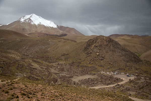 Picture of The ghost town of San Antonio de Lípez below snow-capped Cerro Lípez - Bolivia - Americas