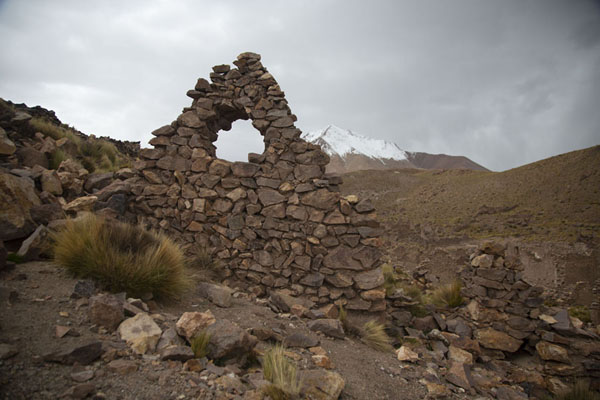 Ruins of San Antonio de Lípez with the snow-capped mountain in the background | San Antonio de Lípez ghost town | Bolivia