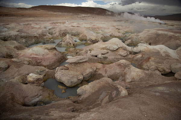 Foto van Afternoon view of the Sol de Mañana area with geysers and steam coming out of the earthSol de Mañana - Bolivia