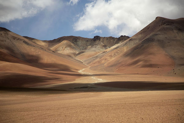 Shadows of clouds over the red-brown landscape of southwest Bolivia | Southwest Bolivia landscapes | Bolivia