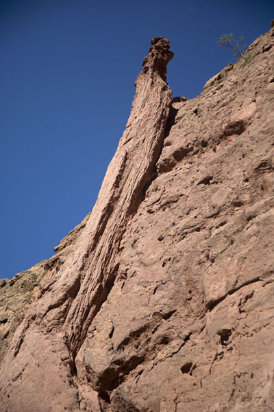 Close-up of a pillar-like formation leaning against the rock wall of the small canyon | Tupiza canyons | Bolivia