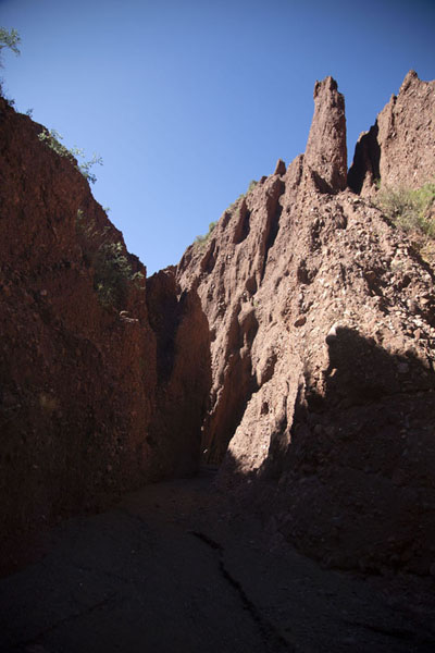 Picture of Rock formation towering high above a narrow section of the small canyon