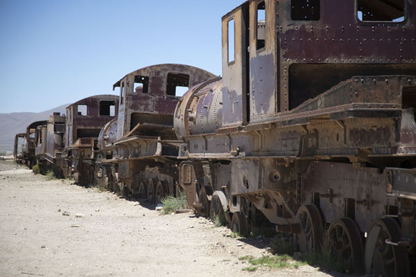 Row of locomotives and carriages at the train cemetery of Uyuni | Train cemetery | Bolivia