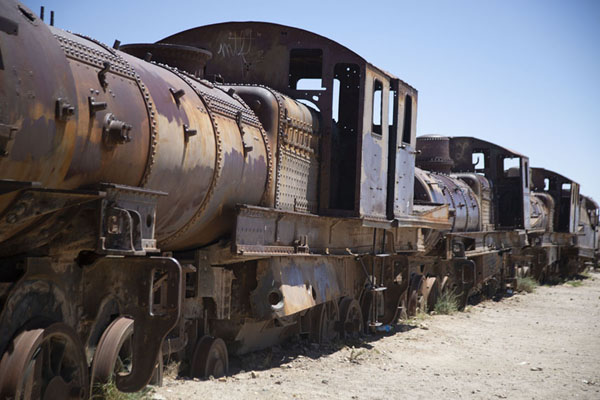 Picture of Locomotives and carriages in a long row at the train cemetery near Uyuni - Bolivia - Americas