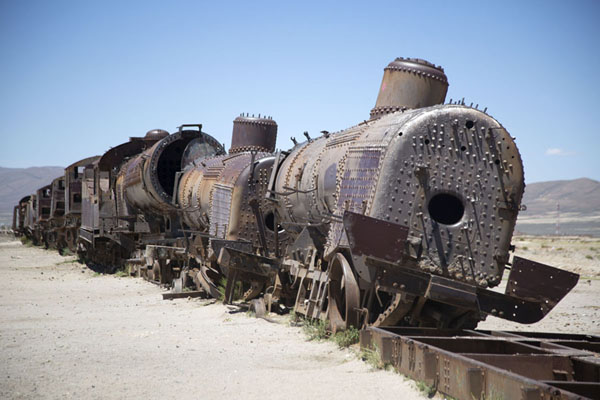 Foto van Long row of carriages at the train cemeteryUyuni - Bolivia
