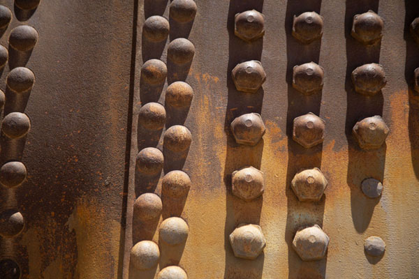 Close-up of rusty train at the cemetery | Train cemetery | Bolivia