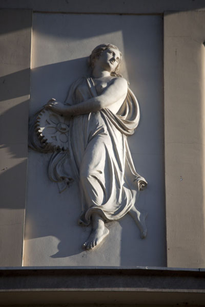 Female sculpture on the facade of a building on the Miljacka riverbank | Austro-Hungarian Sarajevo | Bosnia and Herzegovina
