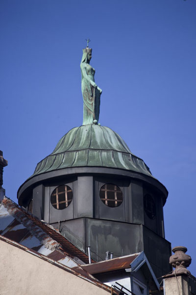 Tower topped by a statue on top of a building in downtown Sarajevo | Austro-Hungarian Sarajevo | Bosnia and Herzegovina