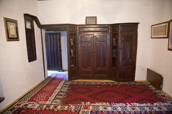 Picture of Red carpets and wooden closet in a room of the tekke of Blagaj