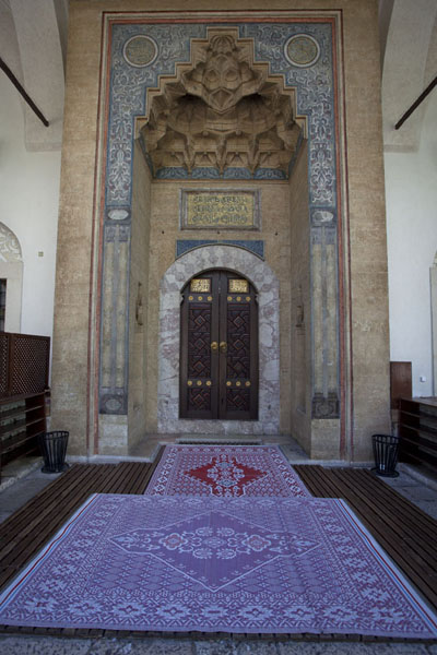 Picture of Carpet and richly decorated door at the entrance of Gazi Husrev Bey mosque - Bosnia and Herzegovina - Europe