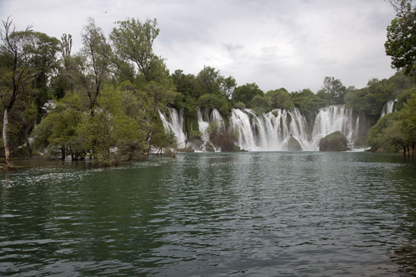Picture of Kravice waterfalls (Bosnia and Herzegovina): View towards the Kravice falls across the lower part of the Trebižat river