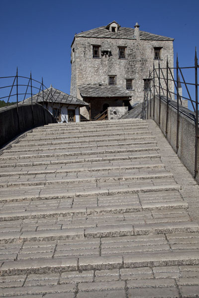 Picture of The stone steps of the Old Bridge of Mostar with the Tara Gunpowder Tower on the other side - Bosnia and Herzegovina - Europe