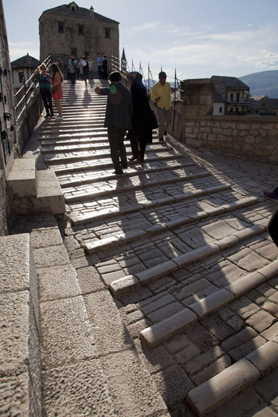 Picture of Shadows of people walking the bridge of Mostar - Bosnia and Herzegovina - Europe