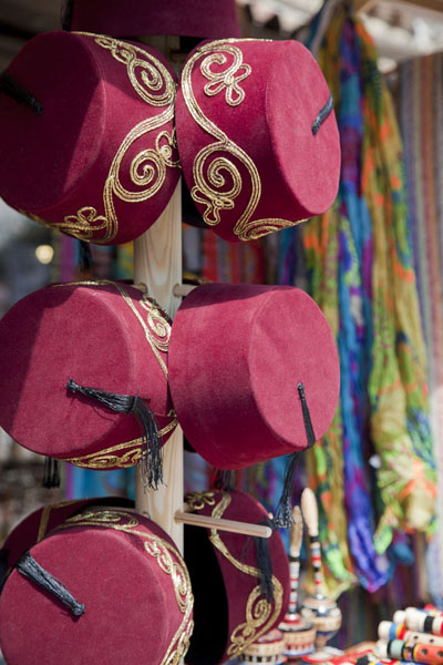 Red fez for sale at one of the many shops in the Baščaršija area | Ottoman Sarajevo | Bosnia and Herzegovina