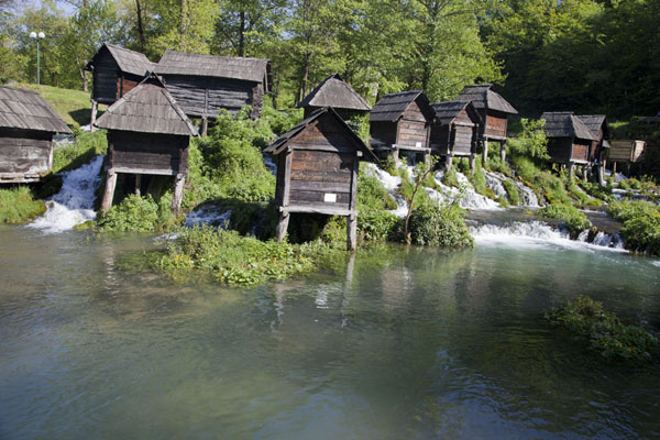 The famous wooden watermills between the large and small Pliva lake | Pliva Lakes | Bosnia and Herzegovina