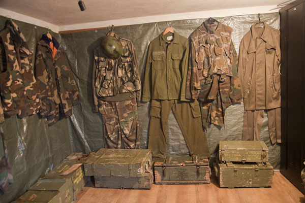 Military uniforms on display in the museum | Tunnel of Life | Bosnia and Herzegovina